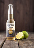 Editorial photo of bottle of Corona Extra Beer with lime on dark wooden background. MINSK, BELARUS - MARCH 27, 2017: Editorial photo of bottle of Corona Extra royalty free stock photos