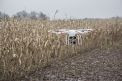 Editorial photo of a DJI Phantom drone in flight with a mounted GoPro Hero3 Black Edition Stock Photography