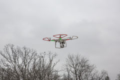Editorial photo of a DJI Phantom drone in flight with a mounted GoPro Hero3 Black Edition. St.Louis Missouri. - DECEMBER19: Editorial photo of a DJI Phantom stock images