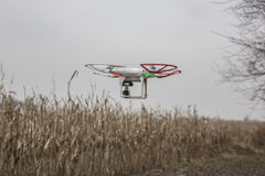 Editorial photo of a DJI Phantom drone in flight with a mounted GoPro Hero3 Black Edition Royalty Free Stock Images