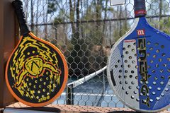 Editorial platform paddle at private club for sport exercise. POUND RIDGE, NEW YORK-APRIL 18: Platform tennis paddles are seen at private club platform paddle Royalty Free Stock Image