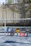Editorial platform tennis court with paddles Stock Photo