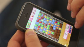 Editorial: Playing the popular app game Candy Crash on a smartphone stock video