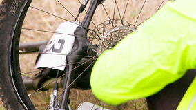 EDITORIAL. Professional Cyclist Repairing The stock footage