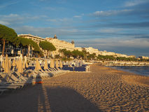 Editorial Promenade de la Croisette Cannes France. CANNES-SEPT. 13: The beach at dusk is seen in Cannes, France with Carlton and Martinez hotel and cafes on Royalty Free Stock Photos
