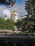 Editorial Riga, Latvia Christ of Orthodox Cathedral and park. RIGA, LATVIA-SEPT. 27: The domes of The Nativity of Christ Orthodox Cathedral are seen as tourist Stock Photos