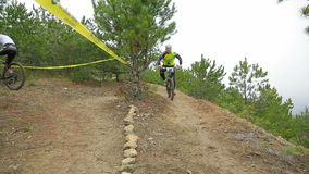 EDITORIAL. Several Cyclists Moving On Two Way Path stock video footage