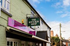 Editorial: Sign for the Knockin Shop pun of Knocking Shop. UNITED KINGDOM – SEPTEMBER 16 Sign for the Knockin Shop pun of Knocking Shop on September 16 stock photos