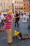 Editorial Street singer or busker in Piazza Navone, Rome, Italy Stock Photo