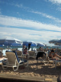 Editorial sunbather Cannes France. CANNES,FRANCE-SEPT. 13:  Sunbathers are seen enjoying the famous beach in Cannes, France just off Promenade de la Croisette on Royalty Free Stock Photography