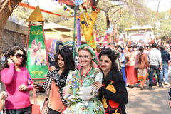 Editorial: Surajkund, Haryana, India:Feb 06th, 2016:Spirit of Carnival in 30th International crafts Carnival. Artists in traditional dresses and enjoying the royalty free stock photo