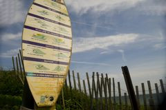 Editorial surfer rules on surf board with Ditch Plains beach bac. MONTAUK, NEW YORK-JUNE 8: Sign of surfer rules of etiquette on on surf boar in Ditch Plains Stock Photo