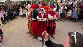 Editorial: 9th June 2019: Chatenois, France. Fancy-dress medieval carnival under fortress walls. In Alsace stock video footage