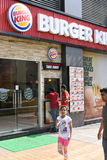 Editorial, 07th June 2015:Gurgaon,Delhi,India: Unidentified people at Burger King joint in DT Shopping Mall Royalty Free Stock Photo