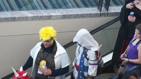 EDITORIAL USE ONLY: RALEIGH, NC, USA (May 2014) - Animazement attendees on an escalator