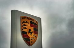 Editorial: 09.23.2018 Willich, Germany: Porsche brand logo post. Porsche car brand logo post taken on a rainy day in Germany stock image