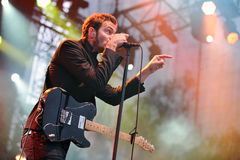 Editors. Singer Tom Smith of Editors during performance on festival Rock for People in Hradec Kralove, Czech republic, July 6, 2010 Stock Photography