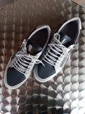 Edizione 04 del nero di scarpe Immagine Stock