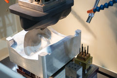 EDM Industrial machine working with coolant injection in the factory Stock Image