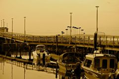 Edmonds Moorage boats 3. Edmonds, Washington moorage is a scenic and idyllic place to enjoy a walk. Boats of all types can be found there. Photo in sepia style Stock Images