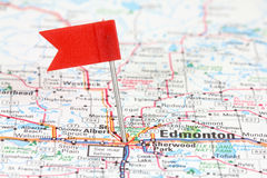 Edmonton. In Alberta, Canada. Red flag pin on an old map showing travel destination royalty free stock photo