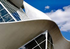 Edmonton Art Gallery. Roof, curves, with blue sky and clouds in background Stock Photos