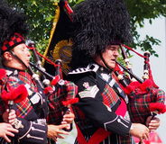 Edmonton City Police Pipe Band In K-Days Parade Royalty Free Stock Image