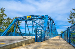 Edmonton Dawson Blue Bridge. This metal blue bridge is the Dawson Bridge located in Edmonton, Alberta. This connection is mainly used for public daily commute royalty free stock images