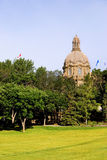 Edmonton Legislative Building of Alberta. The peak of the Edmonton, Alberta Legislative Building rises above the trees of a nearby park Stock Photography