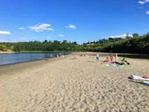 Edmonton locals enjoying time at a newly developed beach along the banks of the North Saskatchewan River. stock images