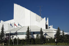 Edmonton Science centre. Flags flutter in the breeze in front of modern building - the Edmonton Science Center Stock Images