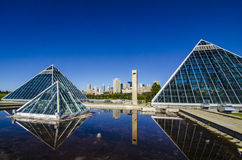 Edmonton Skyline Behind the Pyramids. A shot of the Edmonton skyline behind the glass pyramids of the Muttart Conservatory royalty free stock photography