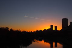 Edmonton Skyline With Condensation Trail Royalty Free Stock Images