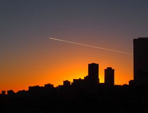 Edmonton Skyline With Condensation Trail Royalty Free Stock Photography