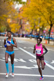 Edna Kiplagat (Kenya) followed by Diane Nukuri-Johnson (USA) run the 2013 NYC Marathon Royalty Free Stock Images