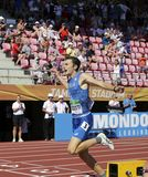 Edoardo Scotti che vince il relè dei tester 4X400 nel campionato del mondo U20 di IAAF a Tampere, Finlandia 15 luglio 2018 fotografia stock
