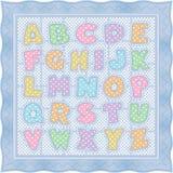 Edredón del alfabeto en puntos y verificaciones en colores pastel de polca Imagen de archivo libre de regalías