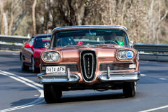 1958 Edsel Citation Convertible. Adelaide, Australia - September 25, 2016: Vintage 1958 Edsel Citation Convertible driving on country roads near the town of Stock Photo