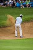 Eduardo Molinari - Bunker Shot. Eduardo Molinari strikes the ball with a sand wedge to get out of the bunker & onto to the 8th green Stock Photos