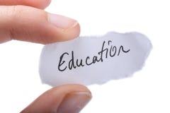 Educação escrita uma parte de papel rasgado Imagens de Stock