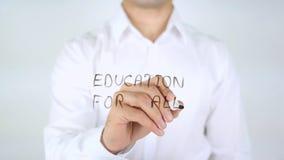 Educação para tudo, escrita do homem no vidro Fotografia de Stock Royalty Free