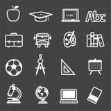 Educación de nuevo a iconos de la escuela y a fondo negro Fotos de archivo