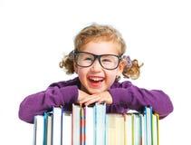 Educación - muchacha divertida con los libros. Fotos de archivo