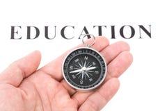 Educación y compás del título imagenes de archivo