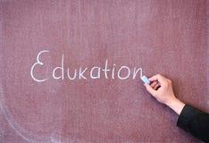 Educación de la palabra escrita en la pizarra Imagen de archivo