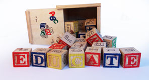 Educate spelled on preschool alphabet blocks. Extreme close up of the word educate spelled with preschool alphabet blocks Stock Image