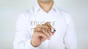 Educate Yourself, Man Writing on Glass. High quality Royalty Free Stock Photo