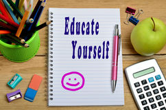 Educate yourself words. On notebook Royalty Free Stock Photos