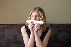 Educated. Portrait of woman with napkin stock photography