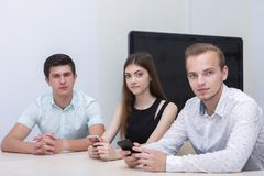 Educated advertisers, two guys and girl develop and place ads, conduct marketing research stock images